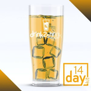 A glass of ice with an orange drink